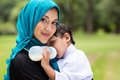 Arabic mother baby beautiful and boy outdoors Stock Image