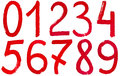 Arabic numerals hand written by red paint set of on white background Royalty Free Stock Image
