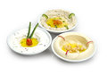 Arabic traditional hummus plates with different toppings isolated on white Royalty Free Stock Image