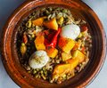 Arabic tajine with eggs and green olives in Morocco Royalty Free Stock Photo