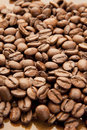 Arabica beans medium roasted spread out and seen from closeup Stock Photo