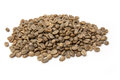Arabica coffee beans pile of green on a white studio background Royalty Free Stock Images