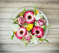 Arangement with roses and gerberas flowers in the glass bowl wit Royalty Free Stock Photo