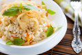 Arborio rice with onions in a white bowl Royalty Free Stock Photo