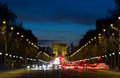 Arc de triomphe and traffic the at the end of the avenue des champs elysees with the lights from Royalty Free Stock Images