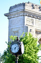 Arc de triumph and an old clock in herastrau park bucharest romania Stock Photography