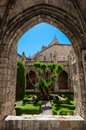 Arc and garden at saint just cathedral cloister at narbonne in france Stock Photos