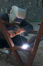 Arc welding man using an welder Stock Image