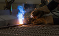 Arc welding and welding fumes in manufacturing factory Stock Photo