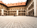 Arcades of wawel castle in krakow courtyard with white poland Stock Images