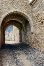 Arch of the ancient fortress dark tunnel corridor with Stock Images