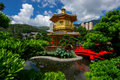 Arch Bridge and Pavilion in Nan Lian Garden, Hong Kong. Royalty Free Stock Photo