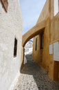 Arch and causey on santorini island buildings with Stock Photography