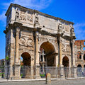 The Arch of Constantine and the Coliseum in Rome, Italy Royalty Free Stock Photo