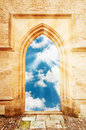 Arch door opening to beautiful cloudy sky sun rays Royalty Free Stock Photo