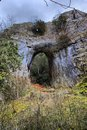 Arch formed in a rockface Royalty Free Stock Photography