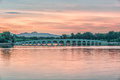 Arch lion bridge the famous in summer palace under the sunset outside of beijing china Royalty Free Stock Image