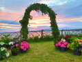 An arch of matrimony with a beautiful red sky in the background Stock Photography