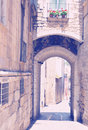 Arch over old narrow street of european city Royalty Free Stock Photo