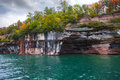 Arch pictured rocks with colorful textured and trees Royalty Free Stock Image