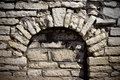 Arch in stone wall Royalty Free Stock Photos
