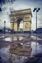 Arch of triumph and a puddle Royalty Free Stock Photo