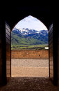 Arch view of swiss alps in gruyere switzerland from the medieval castle on the Royalty Free Stock Photos