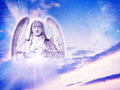 Archangel uriel with rays of light Stock Photo