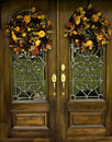 Arched Beveled front doors with Fall Wreths Royalty Free Stock Photo