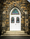 Arched Church Door in Stone Wall Royalty Free Stock Photo