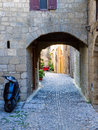 Arched cobblestone lane in the old town of rhodes greece Royalty Free Stock Photo