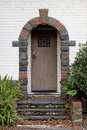 Arched doorway and leaf covered stairs Royalty Free Stock Photo