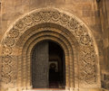 An arched museum doorway with carvings and metal doors in armenia Stock Photos