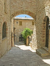 Arched passageway in Tuscany Stock Images