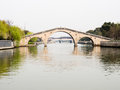 Arched stone bridge over a canal in Suzhou Royalty Free Stock Photo