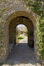 Arched walkway with open door view of Stock Images