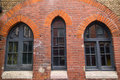 Arched warehouse windows exteriror of an old Royalty Free Stock Photo