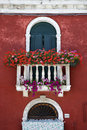 Arched Window with Balcony and Flowers Royalty Free Stock Photo