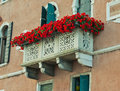 Arched window with balcony and flowers in venice italy Stock Image