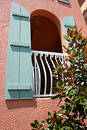 Arched window with blue shutters Royalty Free Stock Photography