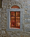Arched window lit chios island greece Royalty Free Stock Image