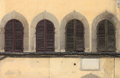 Arched windows with closed shutters Royalty Free Stock Photo