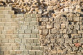 Archeological layers rebuilt of an old wall on an site Stock Photo