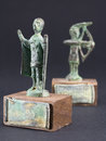 Archer bronze statuette and chieftain praying with cloak and sti stick fgurine Royalty Free Stock Photos