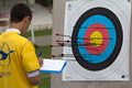 Archer checking his archery accuracy auch france may an unidentified competitor is at the national tournament for young archers on Stock Images