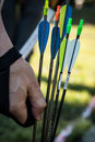 Archery for active people having fun in the forest adventure park and Stock Photo