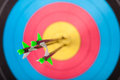 Archery arrows in target photo Stock Photo
