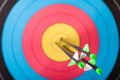 Archery arrows in target photo Stock Images