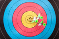 Archery arrows in target photo Royalty Free Stock Images