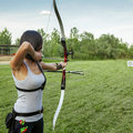 Archery attractive female practicing at the range Stock Images